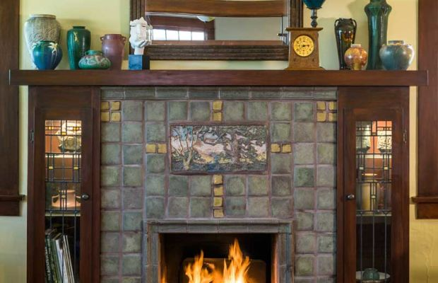 Seemingly historic in the tradition of Batchelder tile, the living room's fireplace surround, a handsome focal point, is actually new work by tile artist Laird Plumleigh.