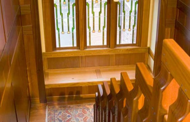 Art-glass windows decorate the stairwell of a new house in the California Arts & Crafts style. From HeartWood Fine Windows.