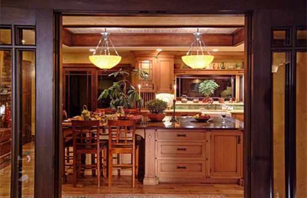 The couple who built this house distressed quarter-sawn oak cabinets and antiqued all the cabinet hardware.