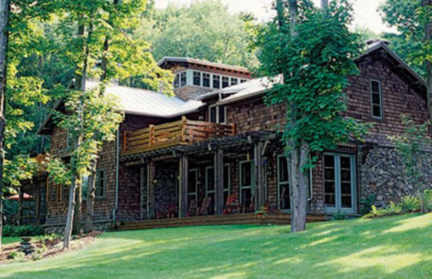 Architect Matthew Bialecki designed this rough stone and cedar shingle retreat in upstate New York -- it's both elegant and in the vernacular.