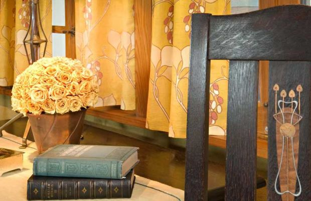 The living room curtains are based on a textile pattern Stickley imported from England and sold through his catalog.