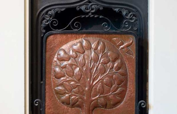 Antique English A&C firescreen and fender in copper, by John Pearson. (Photo: Duncan McNeil)