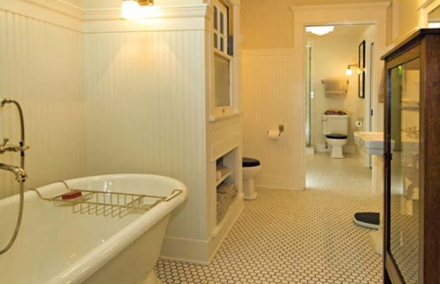 Two interconnected bathrooms fit right in; materials are the same as baths of the early 20th century. Photo by Chris Considine.