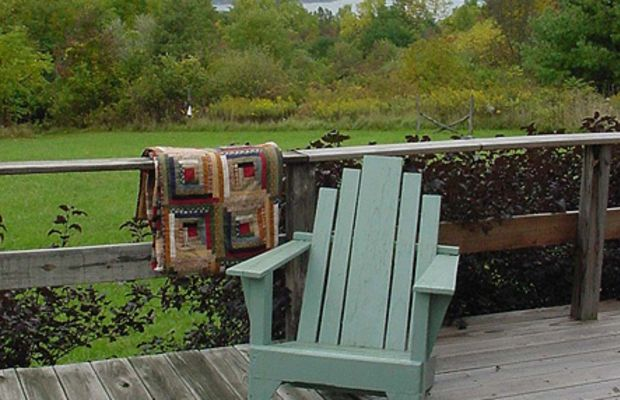 A Forties Adirondack chair has Deco styling.