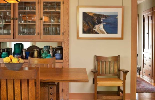 The dining room is centered on a Stickley-design oak table from Hile Studio, Inc.