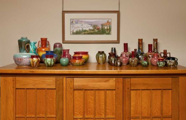 Bretby and Linthorpe pieces are clustered atop a Greene and Greene-style cabinet in the living room.