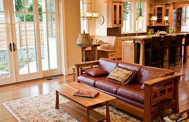 Arts & Crafts furniture, French doors, and cabinets with cloud-lift details are period inspired.
