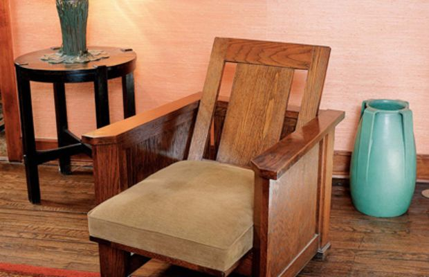 Frank Lloyd Wright's version translated the Morris chair to a Prairie School form.