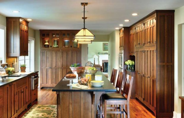 This new kitchen in the Craftsman style was inspired by Stickley furniture: Handcrafted cabinets are made of quarter-sawn white oak with a 'Copper Brown' finish that Crown Point developed to match Stickley's 'Onondaga' furniture finish.