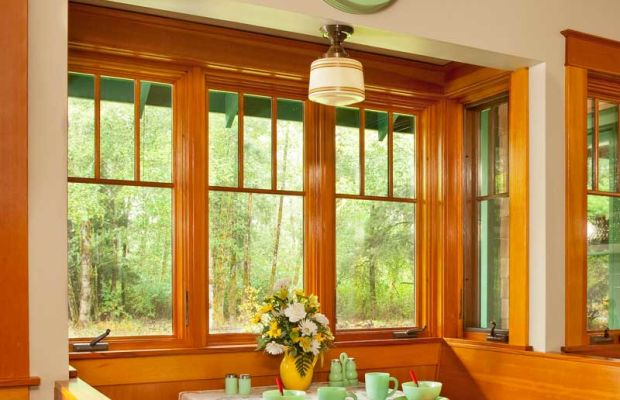 Three-over-one sash windows surround the breakfast nook in this new house.