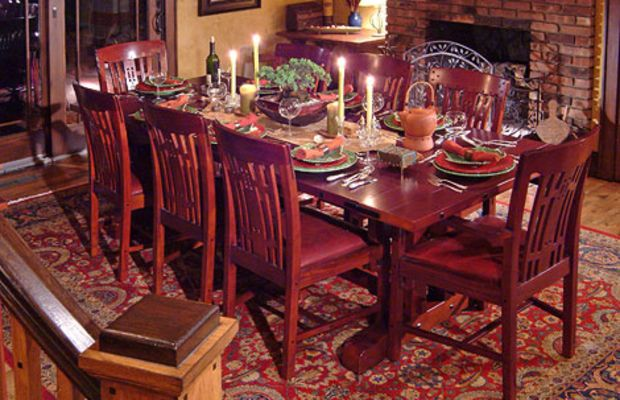 Their hand-applied ceiling treatments are a highlight in the dining room, great room, and kitchen.  Dining room furniture is reproduction.