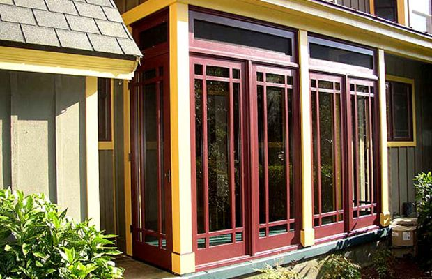 A three-season, Prairie style porch from Touchstone Woodworks, made of mahogany panels and well engineered for longevity.