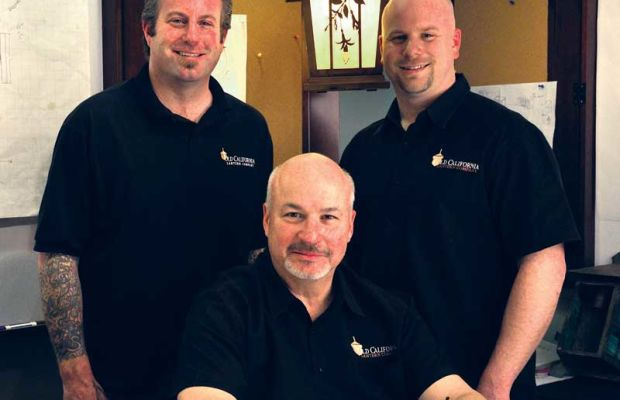 Old California Lantern founder Tom Richard with sons Nathan and Craig.