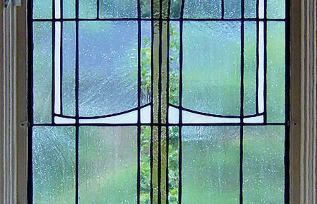New stained- and leaded-glass window reminiscent of Mackintosh, by Susan McCracken of Architectural Artworks.