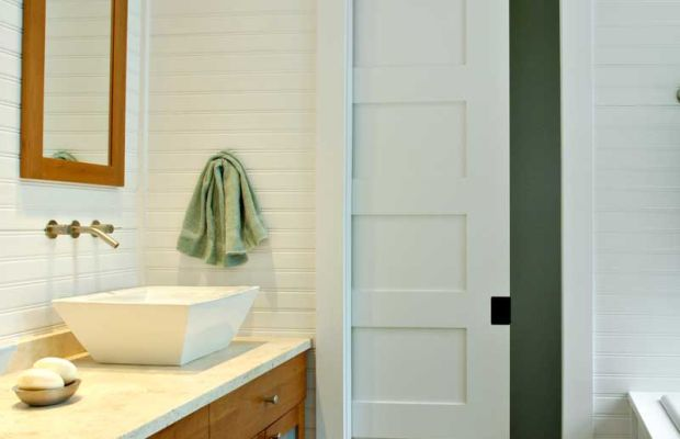 A five-panel sliding door in a new-build cottage bathroom By Richard Bubnowski.