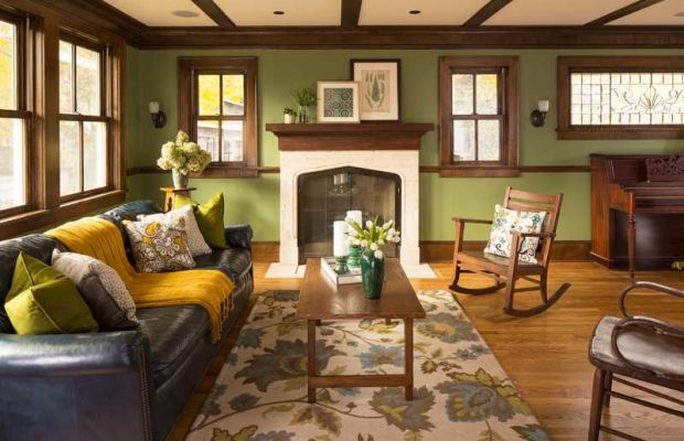 "The travertine Tudor fireplace surround is an antique; it was the perfect shape and size, easily altered to fit modern fire code. About the lovely Tudor arch, owner Mary Griffin says, ""I admit to being something of an Anglophile."" Photos by Troy Thies"