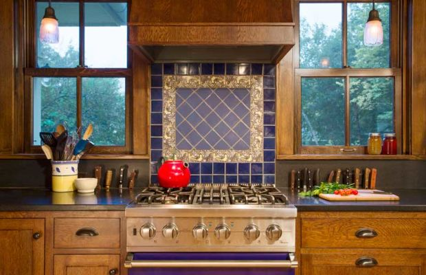 Decorative tile collected in England became the centerpiece of the range backsplash.