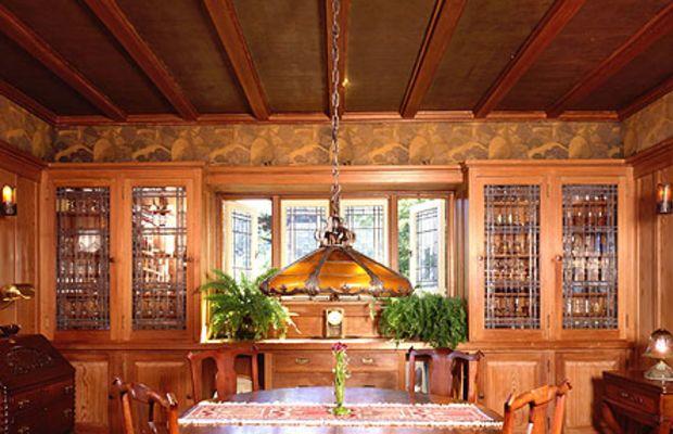 A dark, textured ceiling paper covers panels between beams.