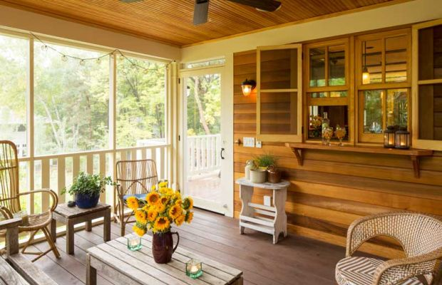 The screened porch off the kitchen leads to Ray's grilling deck. Horizontal siding is 1x6 tongue-and-groove V-joint cedar, finished with spar varnish.