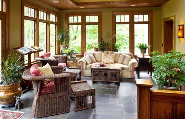 Its bluestone floor keeping the outdoor vibe, the sunroom took the place of a little-used terrace. Salvaged chestnut paneling was used in the half-wall.