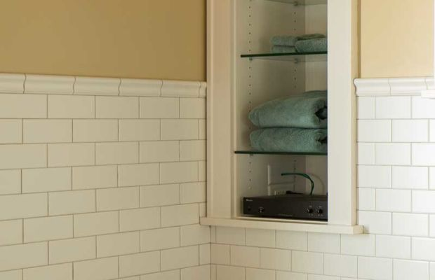 Following vintage examples, shelves recessed into the wall between studs provide handy storage.