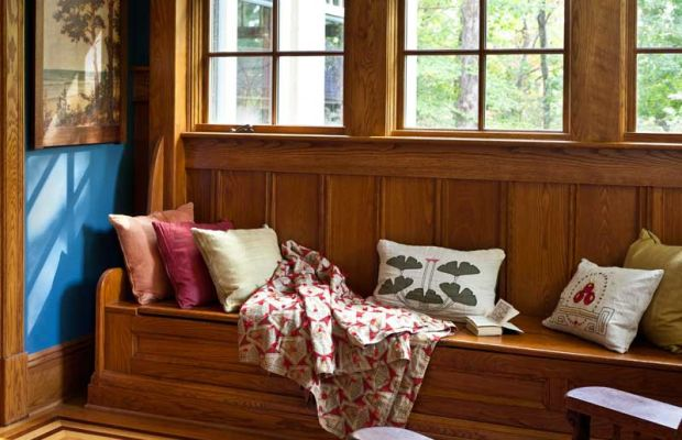 This window seat in an enclosed porch offers extra seating and storage.