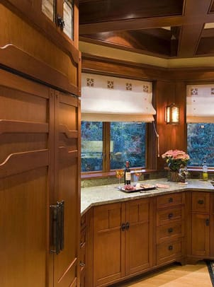 Contemporary convenience is the rule in a new kitchen inspired by the furniture-quality woodwork details of Greene & Greene; this cabinet hides the fridge. Photo by Douglas Keister.
