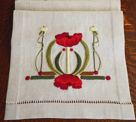 The Poppy table scarf is an original design by Natalie Richards of Paint By Threads