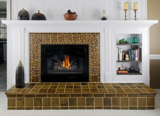 Custom dogwood tiles create a trailing motif on a fireplace surround.