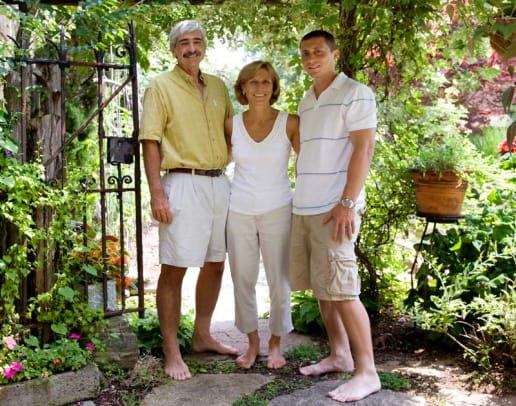 David and Nan Araneo and their son Chad, enjoying the garden.