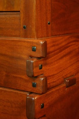 Channeling Greene & Greene: exposed dovetails in mahogany with ebony pegs.
