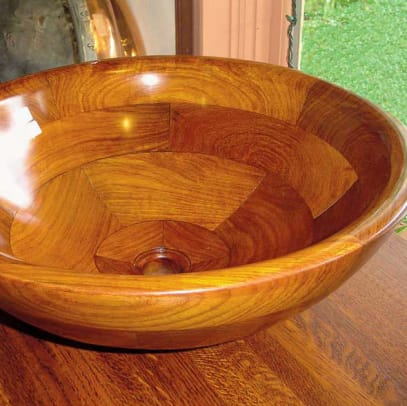 Vessels like this specially sealed wood creation from Bathroom Machineries are popular for secondary sinks.