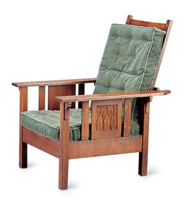The early L. & J.G. Stickley version features carved panels.