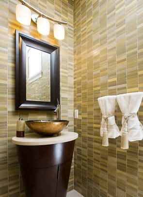 In accordance with LEED certification, bathroom tile must either come from sources within 500 miles, or be made from recycled glass.