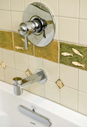 Contemporary bathroom hardware complements period-inspired tile work.