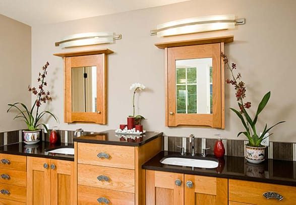 Double sinks and ample storage are present-day conventions, but styling of cabinets and mirror was inspired by the past.