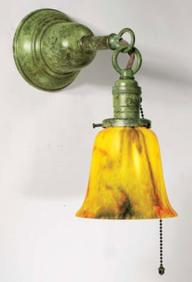 The shade and the metal finish you choose create the look: sconce from Old California Lantern's 'Hollistan' series.