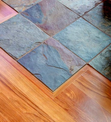 Slate tiles create a transition between outdoor spaces and rooms floored in Brazilian cherry.