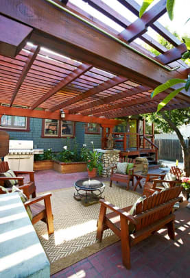 A pergola-shaded patio serves as the outdoor living room.