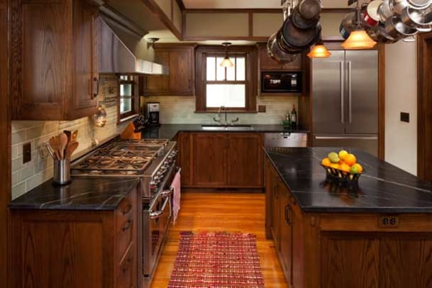 An island, unplumbed, creates an efficient galley near the stove, adding a large work surface and storage to the work triangle.