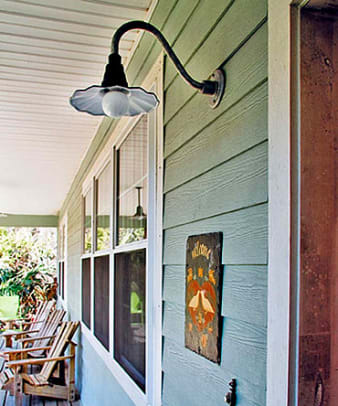 The fluted metal shade and high gooseneck of the Aztec from Barn Light Electric recalls pre-World War II gas-station lighting.