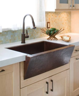 Slant-front styles like Native Trails' 'Zuma' in antique copper recall early washstand sinks.