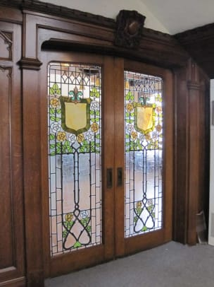 Hidden by bookcases for more than 60 years, the beautiful leaded and stained glass doors were in near-original condition.