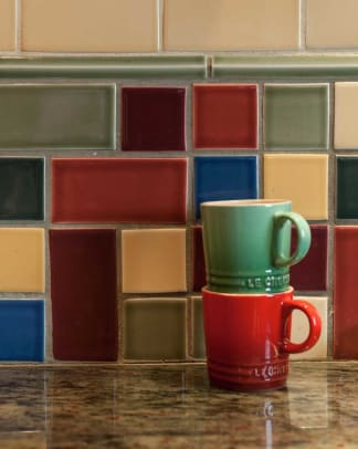 A mixed collage of Ann Sacks tiles in the backsplash adds color and pizzazz.
