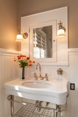 The first-floor bathroom was returned to a period look with wainscoting and woodwork milled to match that in the rest of the house, and a new built-in medicine cabinet.