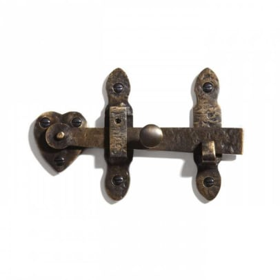 A solid brass gate rim latch with heart motif, from Signature Hardware, comes in three finishes.