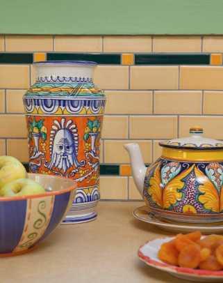 Italian pottery is highlighted against the tile backsplash.