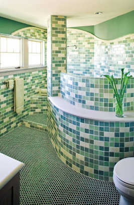 In the new Arizona house, the artful bathroom has a tile installation with round corners that mimic adobe construction. Photo by Tim Fuller.