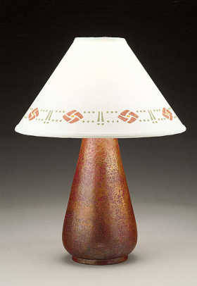 Stenciled lampshade by Helen Foster tops a hammered copper lamp from Cobre.