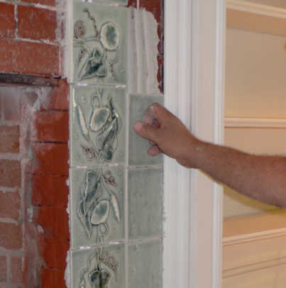 Tiles don't initially line up, so Bill makes subtle adjustments, opening and closing grout joint lines and adding spacers as needed.